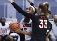 North Carolina State's Jada Boyd (5) looks to shoot as Virginia Tech's Elizabeth Kitley (33) defends during the first half of an NCAA college basketball game in the Atlantic Coast Conference women's tournament in Greensboro, N.C., Friday, March 5, 2021. (Ethan Hyman/The News & Observer via AP)