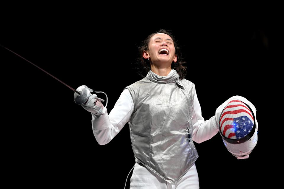 <p>CHIBA, JAPAN - JULY 25: Lee Kiefer of Team United States celebrates after winning the Women's Foil Individual Fencing semifinal 2 against Larisa Korobeynikova of Team ROC on day two of the Tokyo 2020 Olympic Games at Makuhari Messe Hall on July 25, 2021 in Chiba, Japan. (Photo by Matthias Hangst/Getty Images,)</p>