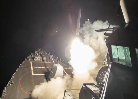 U.S. Navy guided-missile destroyer USS Ross (DDG 71) fires a tomahawk land attack missile in Mediterranean Sea which U.S. Defense Department said was a part of cruise missile strike against Syria  on April 7, 2017.   Robert S. Price/Courtesy U.S. Navy/Handout via REUTERS