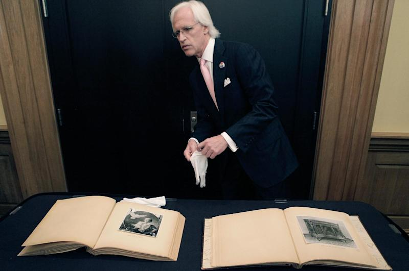 Robert M. Edsel, founder and president of Monuments Men Foundation for the Preservation of Art starts to show two newly discovered albums containing photographs of art works and furniture stolen by the Nazis during World War II after they were unveiled at a news conference in the Meadows Museum at SMU in Dallas, Tuesday, Feb. 27, 2012. The Dallas-based Monuments Men Foundation for the Preservation of Art had been contacted by relatives of two World War II soldiers who took the albums from Hitler's home. They'll be donated to the U.S. National Archives. (AP Photo/LM Otero)