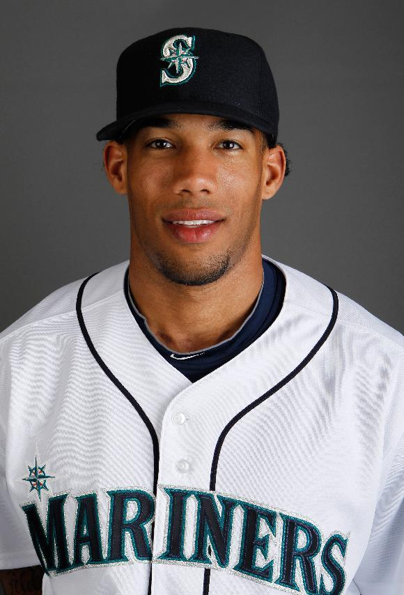 This is a 2010 photo of Greg Halman of the Seattle Mariners baseball team. Dutch police said Monday Nov. 21, 2011 that Halman has been stabbed to death>  (AP  Photo/Charlie Neibergall)
