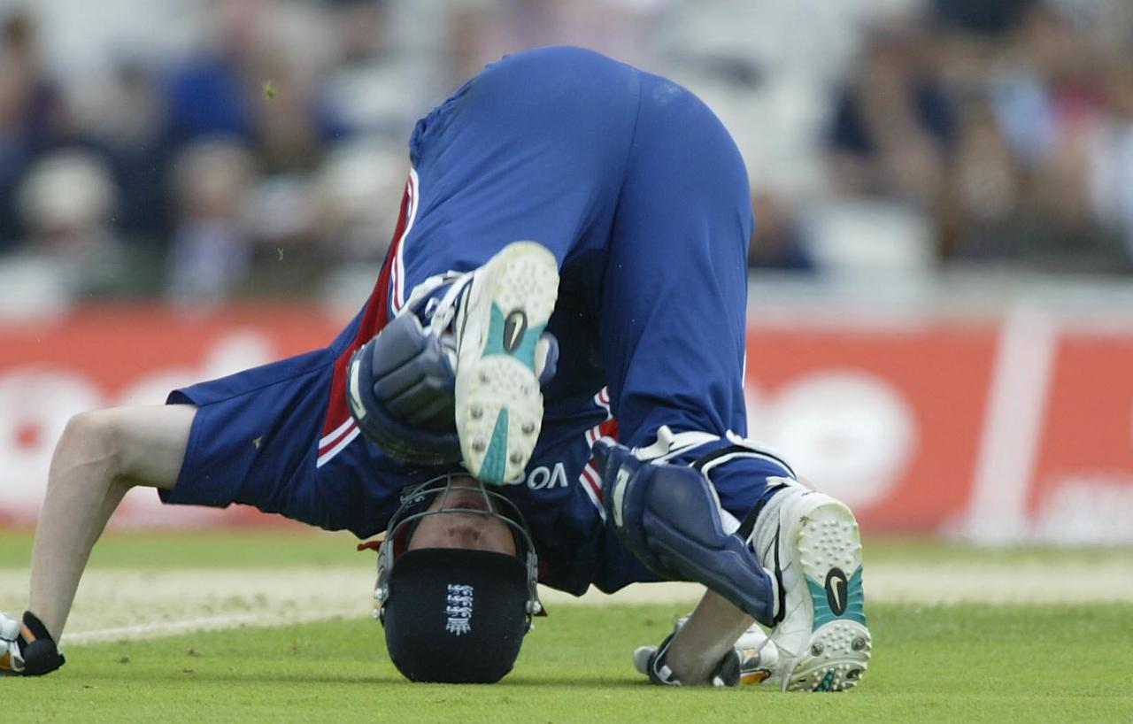 LONDON- JULY 9:  Andrew Flintoff of England takes a tumbles in an attempted run out during the match between England and India in the NatWest One Day Series at the AMP Oval in London, England on July 9, 2002. (Photo by Clive Mason/Getty Images)