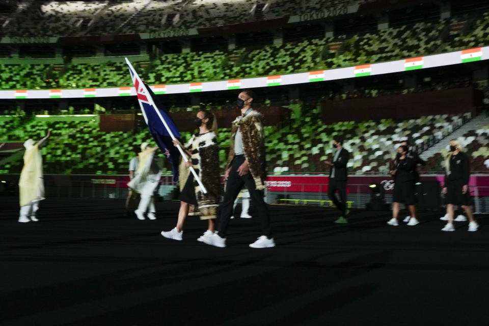 Sarah Hirini and David Nyika, of New Zealand, carry their country's flag during the opening ceremony in the Olympic Stadium at the 2020 Summer Olympics, Friday, July 23, 2021, in Tokyo, Japan. (AP Photo/Natacha Pisarenko)