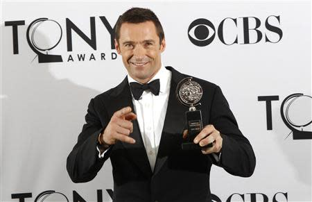 Actor Hugh Jackman holds the Actors' Equity Association award backstage at the 66th annual Tony Awards in New York in this file photo taken June 10, 2012. REUTERS/Andrew Burton/Files