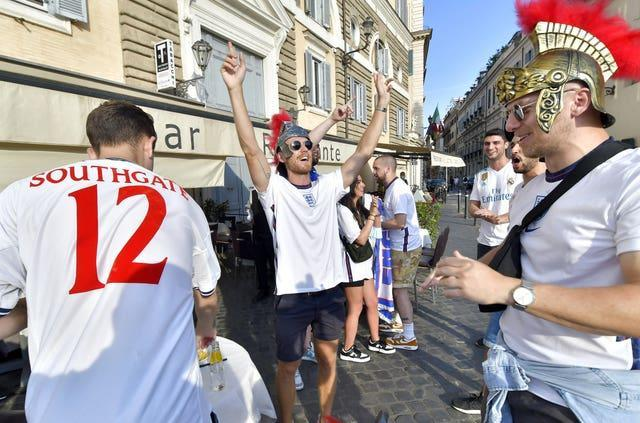 England fans, one in a 'Southgate 12' shirt, prepare for the game against Ukraine