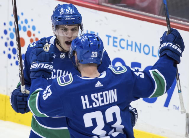 Vancouver Canucks' Bo Horvat (53) and Henrik Sedin (33), of Sweden, celebrate Horvat's goal against the San Jose Sharks during the second period of an NHL hockey game Saturday, March 17, 2018, in Vancouver, British Columbia. (Darryl Dyck/The Canadian Press via AP)