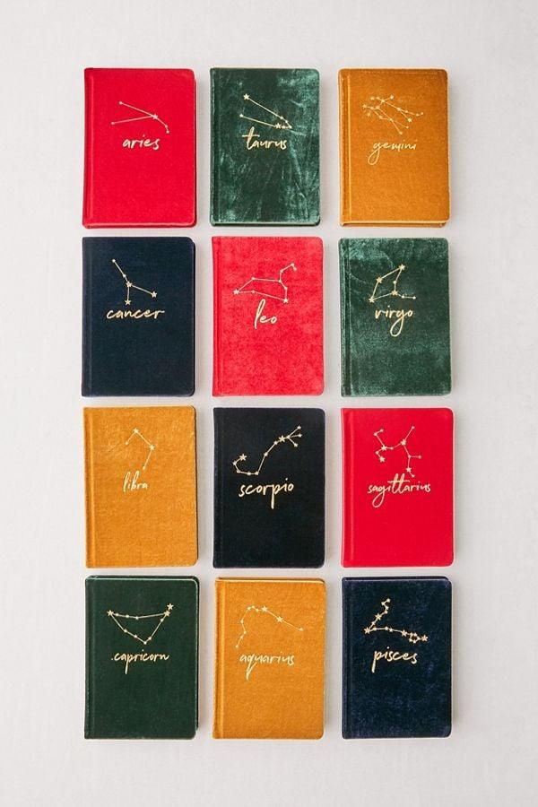"""<p>These <a href=""""https://www.popsugar.com/buy/Velvet-Zodiac-Journals-511499?p_name=Velvet%20Zodiac%20Journals&retailer=urbanoutfitters.com&pid=511499&price=14&evar1=savvy%3Auk&evar9=46695667&evar98=https%3A%2F%2Fwww.popsugar.com%2Fsmart-living%2Fphoto-gallery%2F46695667%2Fimage%2F46850667%2FVelvet-Zodiac-Journal&list1=shopping%2Cgifts%2Curban%20outfitters%2Cgift%20guide&prop13=api&pdata=1"""" rel=""""nofollow"""" data-shoppable-link=""""1"""" target=""""_blank"""" class=""""ga-track"""" data-ga-category=""""Related"""" data-ga-label=""""https://www.urbanoutfitters.com/shop/velvet-zodiac-journal?category=PRODUCTTRAY&amp;color=804"""" data-ga-action=""""In-Line Links"""">Velvet Zodiac Journals</a> ($14) are awesome stocking stuffers.</p>"""