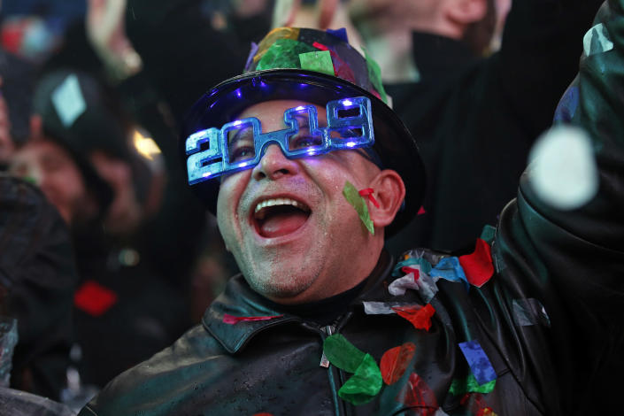 A reveler celebrates as confetti falls during a celebration of the new year in New York's Times Square. (Photo: Adam Hunger/AP)