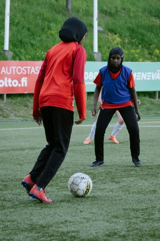 """Kamila Nuh (L) said she """"loves"""" football and is """"not planning on stopping any time soon."""""""