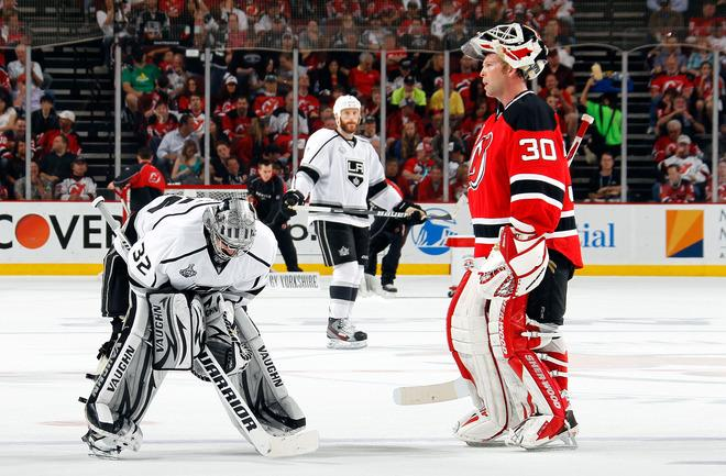 NEWARK, NJ - JUNE 09: Jonathan Quick #32 of the Los Angeles Kings and Martin Brodeur #30 of the New Jersey Devils look on during a stoppage in play during Game Five of the 2012 NHL Stanley Cup Final at the Prudential Center on June 9, 2012 in Newark, New Jersey.  (Photo by Bruce Bennett/Getty Images)