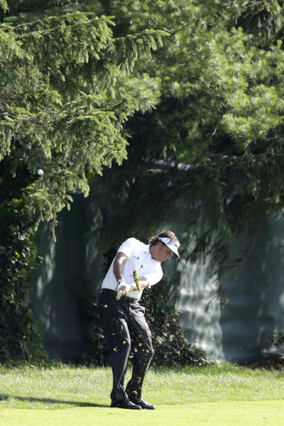 Phil Mickelson hits down the seventh hole during the second round of the U.S. Open golf tournament at Merion Golf Club, Friday, June 14, 2013, in Ardmore, Pa. (AP Photo/Darron Cummings)