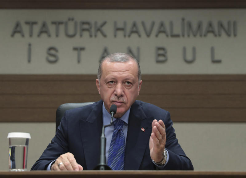 Turkey's President Recep Tayyip Erdogan speaks to reporters before leaving for Bosnia, in Istanbul, Monday, July 8, 2019. Erdogan says Russia's S-400 air defense missiles are currently being prepared to be flown to Turkey.  Erdogan would not however say when the Russian missile defense system would reach Turkey or where they will be deployed.(Presidential Press Service via AP, Pool)