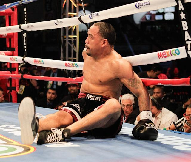 "James Kirkland sits in the ring after being knocked out by Saul ""Canelo"" Alvarez during the third round of their 154-pound boxing bout Saturday, May 9, 2015, in Houston. (AP Photo/Bob Levey)"