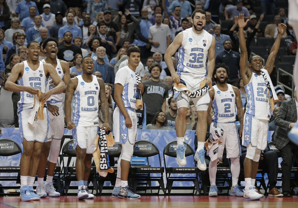 North Carolina players celebrate on the bench late during the second half of a first-round game against Lipscomb in the NCAA men's college basketball tournament in Charlotte, N.C., Friday, March 16, 2018. (AP Photo/Bob Leverone)