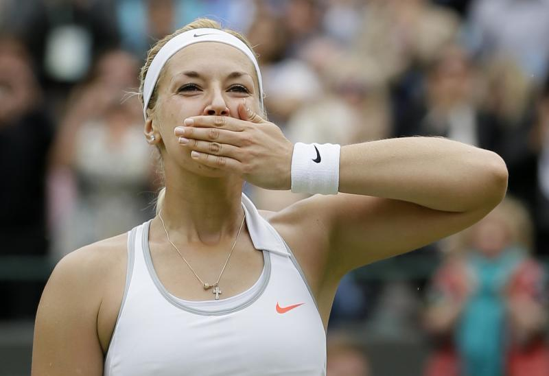 Sabine Lisicki of Germany blows a kiss to the crowd after winning a Women's singles quarterfinal match against Kaia Kanepi of Estonia at the All England Lawn Tennis Championships in Wimbledon, London, Tuesday, July 2, 2013. (AP Photo/Alastair Grant)