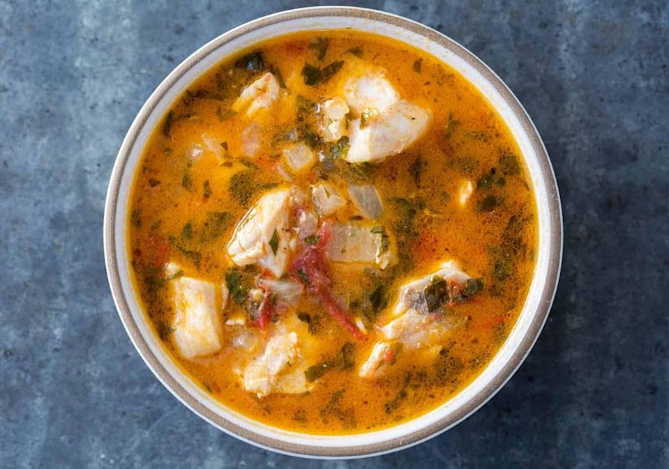 """<p>A white <a href=""""http://www.simplyrecipes.com/recipes/dads_fish_stew/"""" rel=""""nofollow noopener"""" target=""""_blank"""" data-ylk=""""slk:fish stew"""" class=""""link rapid-noclick-resp"""">fish stew</a> cooked in fish stock and white wine. Delicious served with fresh bread to soak up all that lovely sauce.</p><p><i>[Photo: simply recipes]</i></p>"""