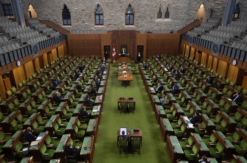 Members of the House of Commons attend an emergency sitting on March 24, 2020 in Ottawa. (Photo: Adrian Wyld/CP)