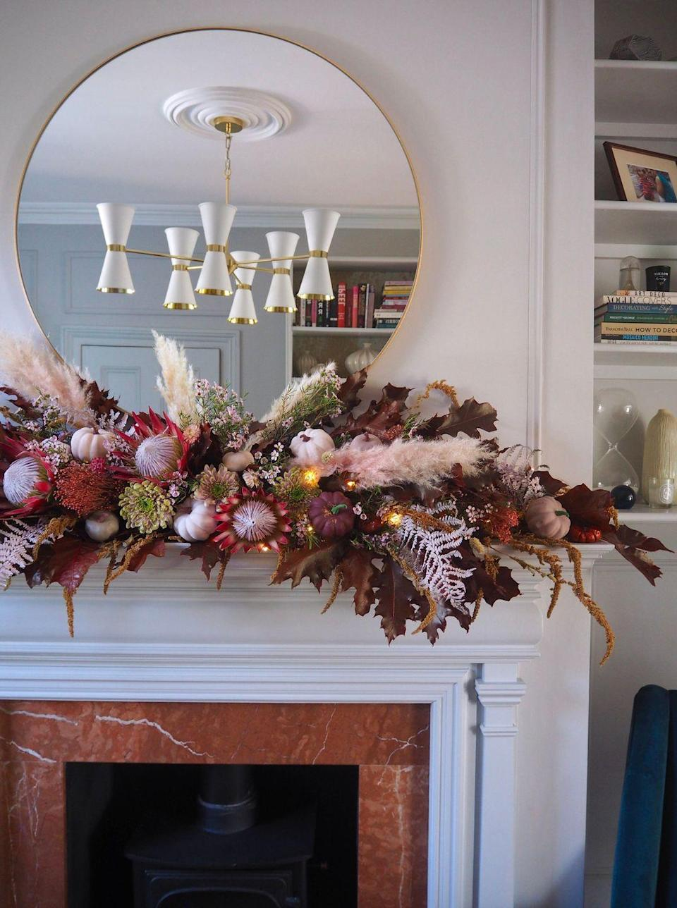 """<p>Layer dark florals, small pumpkins, and pampas grass to create the look. Don't forget the fairy lights!</p><p><strong>Get the tutorial at <a href=""""https://www.melanielissackinteriors.com/blog/2020/9/28/diy-floral-garland-autumn-fall-home-decor"""" rel=""""nofollow noopener"""" target=""""_blank"""" data-ylk=""""slk:Melanie Lissack Interiors"""" class=""""link rapid-noclick-resp"""">Melanie Lissack Interiors</a>.</strong></p><p><a class=""""link rapid-noclick-resp"""" href=""""https://go.redirectingat.com?id=74968X1596630&url=https%3A%2F%2Fwww.walmart.com%2Fip%2F10PCS-20-LED-Copper-String-Fairy-Lights-Wire-Wedding-Xmas-Decor-Battery-Operated%2F698281176&sref=https%3A%2F%2Fwww.thepioneerwoman.com%2Fhome-lifestyle%2Fcrafts-diy%2Fg36891743%2Ffall-mantel-decorations%2F"""" rel=""""nofollow noopener"""" target=""""_blank"""" data-ylk=""""slk:SHOP LED STRING LIGHTS"""">SHOP LED STRING LIGHTS</a></p>"""