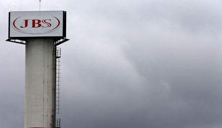 FILE PHOTO: The logo of Brazilian meatpacker JBS SA is seen in the unit   in the city of Jundiai
