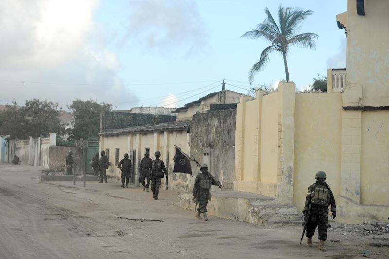 Soldiers belonging to the African Union Mission in Somalia on patrol on October 6, 2014