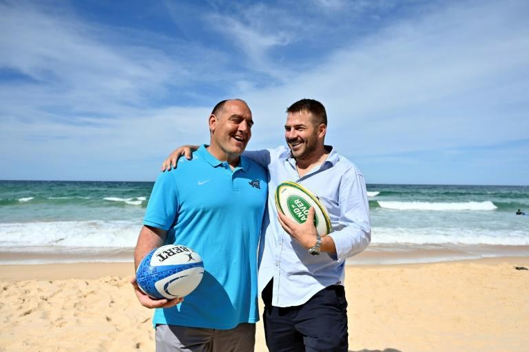 Nice to see you: Argentina coach Mario Ledesma (left) is welcomed to Manly Beach in Sydney by former Wallaby Drew Mitchell after an 'epic adventure' in which the Pumas endured isolation, virus cases and months without rugby ahead of the Tri Nations