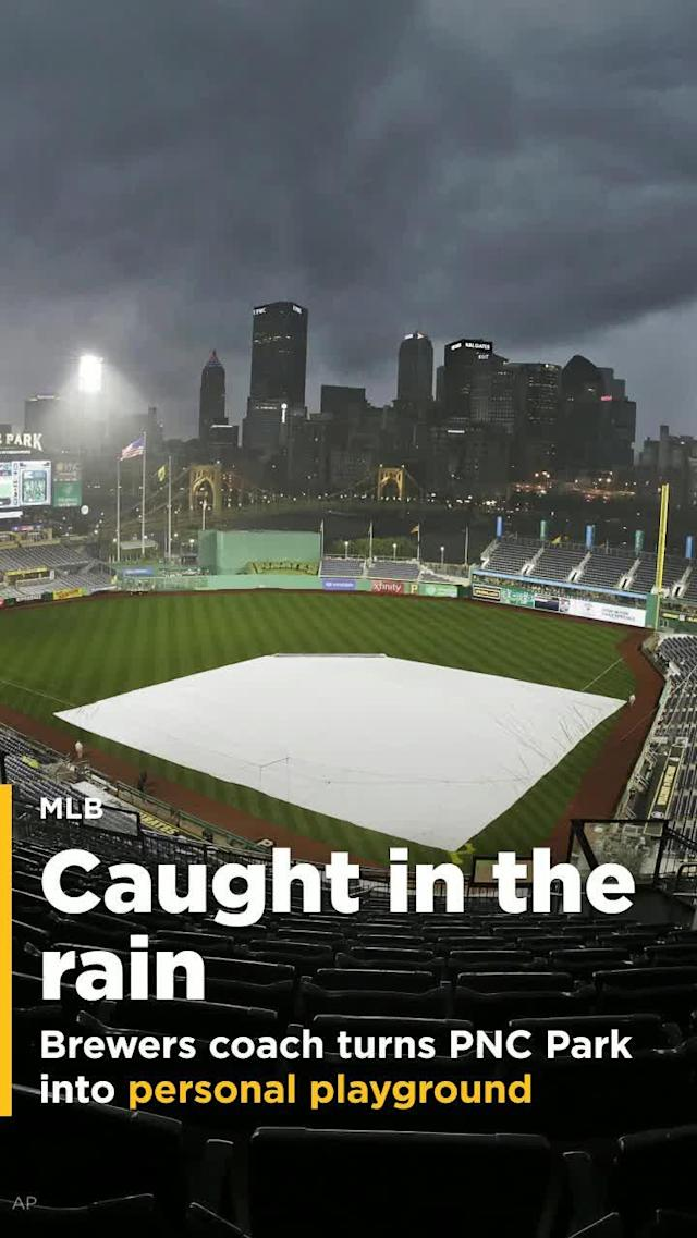Heavy rains at PNC Park in Pittsburgh prevented the Milwaukee Brewers and Pittsburgh Pirates from playing baseball Wednesday night. However, it didn't prevent Brewers bullpen coach Marcus Hanel from playing around on the ball diamond.