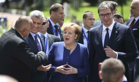 Germany's Chancellor Angela Merkel, Kosovo's President Hashim Thaci and Serbian President Aleksandar Vucic pose among other heads of state during the family photo at the EU-Western Balkans Summit in Sofia, Bulgaria, May 17, 2018. Vassil Donev/Pool via Reuters