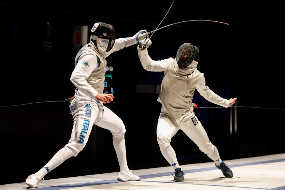 Alessio Foconi (R) of Italy and Andrea Cassara of Italy compete during their men's individual foil fencing final at the FIE World Cup tournament