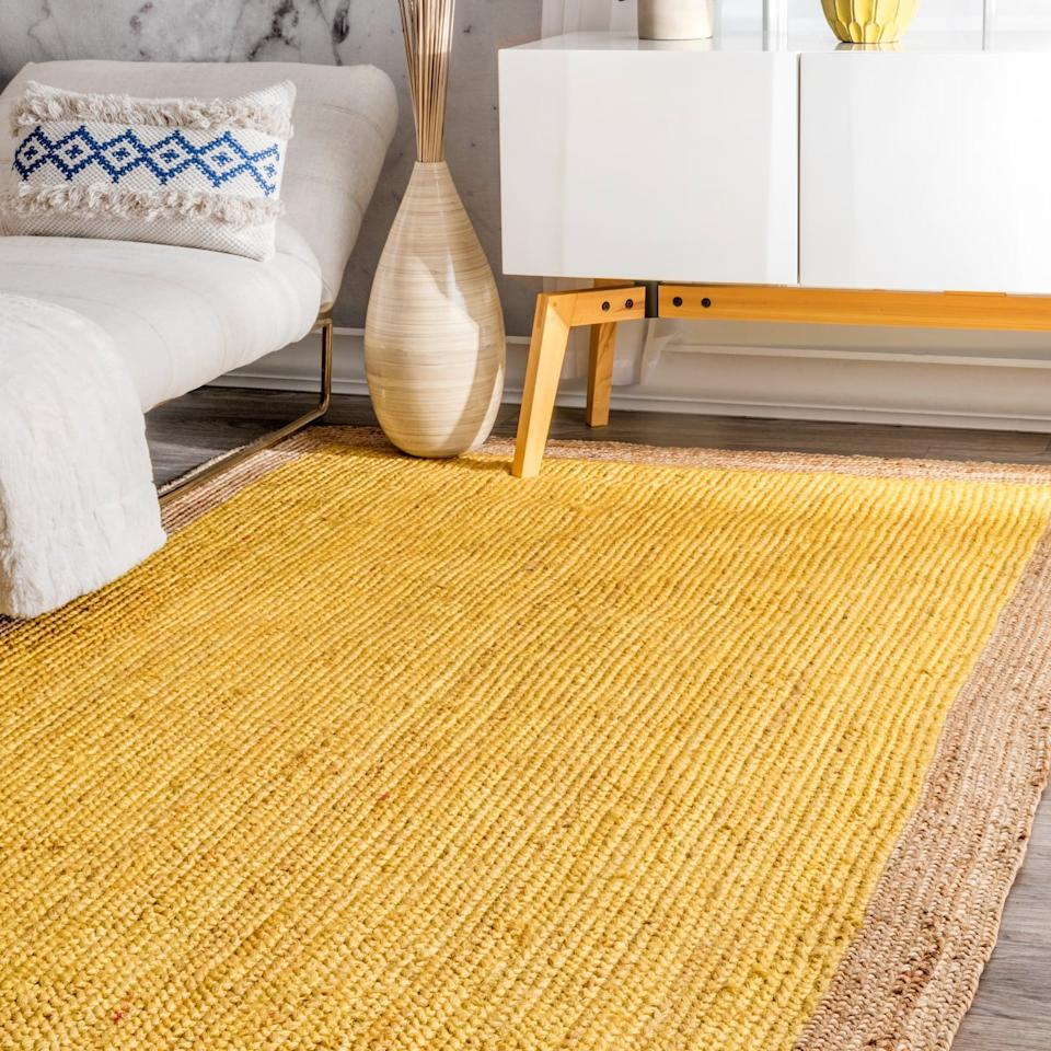 """<a href=""""https://www.amazon.com/dp/B01HDWNJ2S/ref=twister_B07XZ7QL49"""" rel=""""nofollow noopener"""" target=""""_blank"""" data-ylk=""""slk:nuLOOM Handwoven Eleonora Jute Rug"""" class=""""link rapid-noclick-resp""""><h3>nuLOOM Handwoven Eleonora Jute Rug<br></h3></a><br>If you're trying to add bold colors to your room, a bright rug is a good place to start. This hand-woven option features a strong color but with a natural appeal that softens its overall look.<br><br><strong>nuLOOM</strong> Handwoven Eleonora Jute Rug, $, available at <a href=""""https://www.amazon.com/dp/B01HDWNJ2S/ref=twister_B07XZ7QL49"""" rel=""""nofollow noopener"""" target=""""_blank"""" data-ylk=""""slk:Amazon"""" class=""""link rapid-noclick-resp"""">Amazon</a>"""