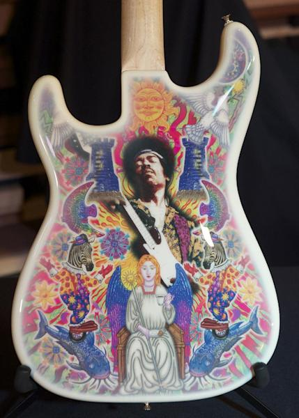 FILE - In a Thursday Feb. 9, 2012 file photo provided by Hard Rock International, a Fender Instruments Stratocaster with artwork by Alan Aldridge is the inspiration for the Jimi Hendrix Signature Series Edition 29 merchandise is photographed at the Hard Rock Cafe Seattle in Seattle. Fender Musical Instruments, the maker of legendary guitars favored by the likes of Buddy Holly, Jimmy Hendrix and Eric Clapton, filed papers Thursday, March 8, 2012 for a $200 million initial public offering. (AP Photo/Hard Rock International, Stephen Brashear, File)