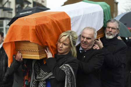 Sinn Feinn Leader Michelle O'Neill and Sinn Feinn President Gerry Adams carry the coffin of Martin McGuinness through the streets of Londonderry, Northern Ireland