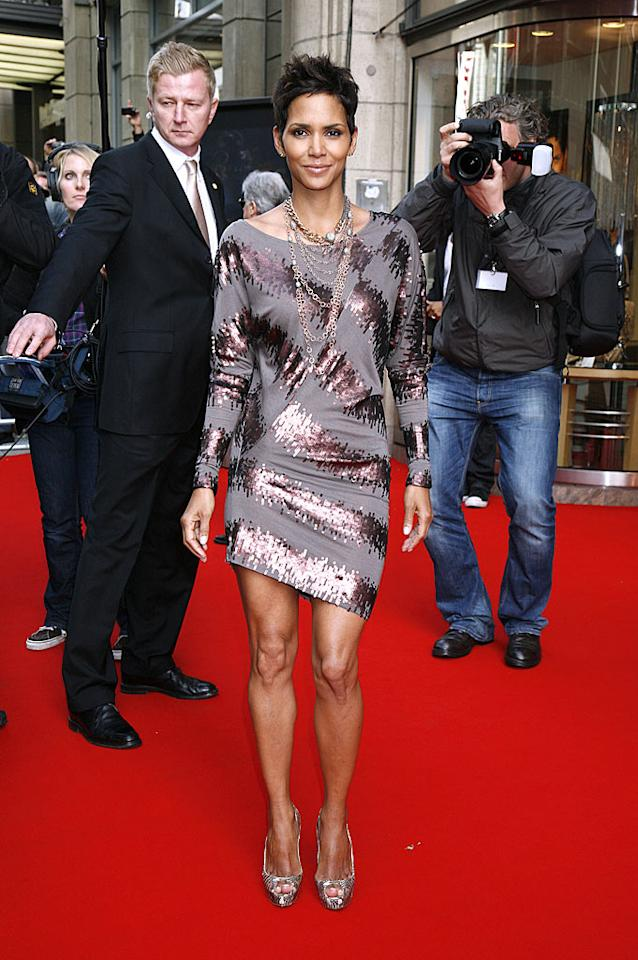 """Meanwhile in Hamburg, Germany, Oscar winner Halle Berry hit the red carpet for the launch of her new fragrance, Reveal, in a polarizing Badgley Mischka frock, matching heels, and layered necklaces. We're not quite sure what to make of her dress. Hot or not? A-way!/<a href=""""http://www.splashnewsonline.com"""" target=""""new"""">Splash News</a> - September 30, 2010"""