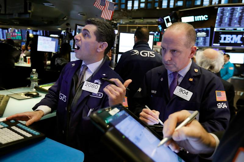 Specialist Peter Mazza, left, and trader Michael Urkonis work on the floor of the New York Stock Exchange, Monday, Jan. 14, 2019. Stocks are opening lower on Wall Street after China reported a surprise drop in exports to the U.S. last month. (AP Photo/Richard Drew)