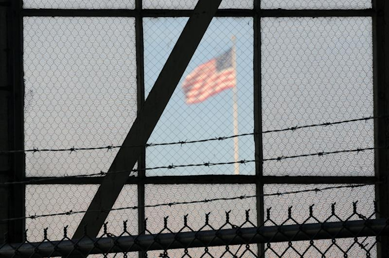 In this photo reviewed by the U.S. Department of Defense, a U.S. flag waves above the the Camp Justice compound, during day three of pre-trial hearings for the five Guantanamo prisoners accused of orchestrating the Sept. 11, 2001 attack, at Guantanamo Bay U.S. Naval Base, Cuba, Wednesday, Oct. 17, 2012. The the five Guantanamo prisoners face charges that include terrorism, conspiracy and 2,976 counts of murder, one count for each known victim of the attacks at the time the charges were filed. They could get the death penalty if convicted. (AP Photo/Toronto Star, Michelle Shephard, Pool)
