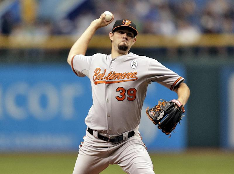 Baltimore Orioles starting pitcher Jason Hammel (39) delivers to the Tampa Bay Rays in the first inning during an opening day baseball game Tuesday, April 2, 2013, in St. Petersburg, Fla. (AP Photo/Chris O'Meara)