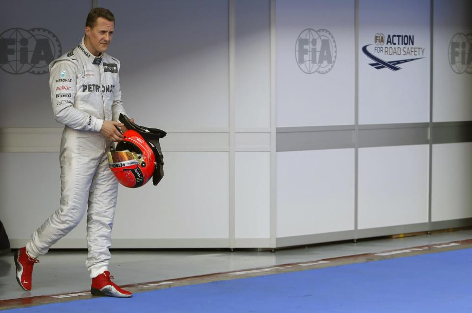 Mercedes Formula One driver Michael Schumacher of Germany walks in parc ferme after the qualifying session of the Malaysian F1 Grand Prix at Sepang International Circuit outside Kuala Lumpur in this March 24, 2012 file photo. Retired seven-times Formula One world champion Schumacher was in 'critical' condition with head injuries after an off-piste skiing accident in the French Alps resort of Meribel, his agent said on December 29, 2013. (REUTERS/Tim Chong)
