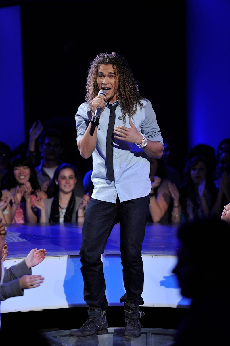 """In this April 4, 2012 photo released by Fox, DeAndre Brackensick performs on the singing competition series """"American Idol,"""" in Los Angeles. (AP Photo/Fox, Michael Becker)"""
