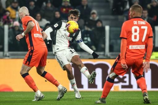 Paulo Dybala lofted the ball into the far corner for the third Juventus goal