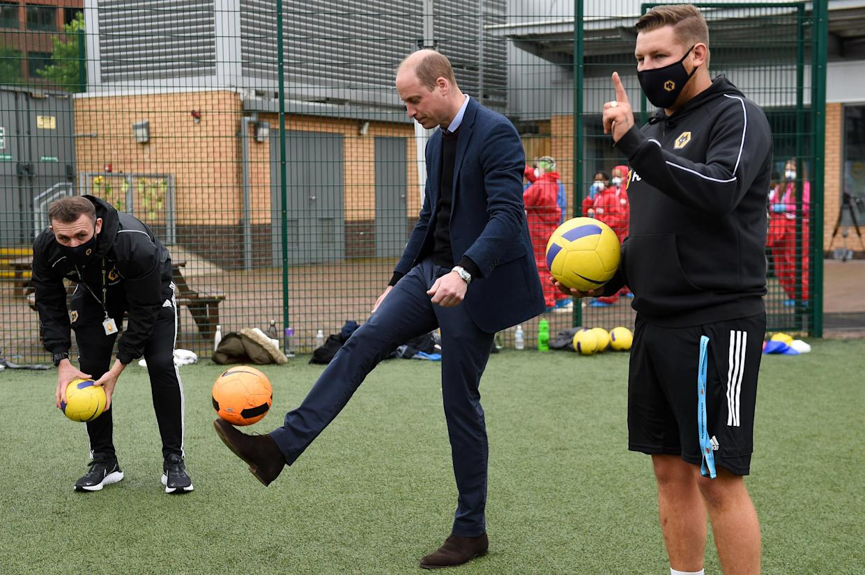 The Duke of Cambridge kicks a football during a visit to The Way Youth Zone in Wolverhampton, West Midlands. Picture date: Thursday May 13, 2021.