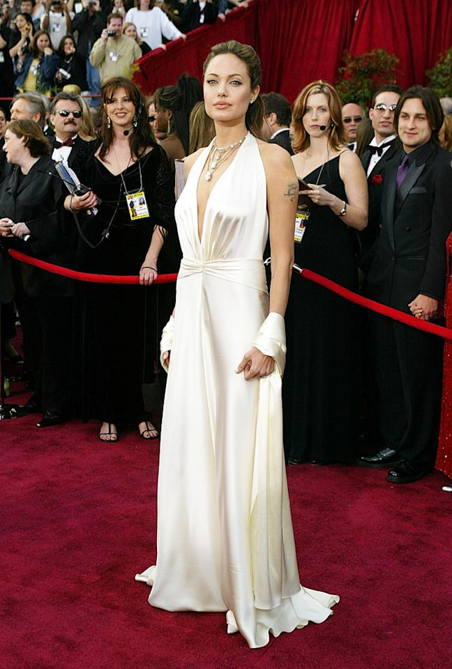 In 2004, Jolie glammed up the Oscars arrivals in a sexy white Marc Bouwer gown.