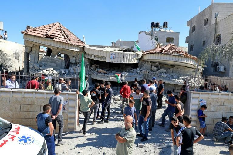 Palestinian villagers in the Israeli-occupied West Bank inspect the remains of the home of a US dual national, demolished by Israeli troops overnight to punish her estranged husband, who is accused of fatally shooting a Jewish student