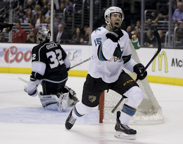 San Jose Sharks left wing James Sheppard, right, celebrates his goal past Los Angeles Kings goalie Jonathan Quick during the first period in Game 4 of an NHL hockey first-round playoff series in Los Angeles, Thursday, April 24, 2014. (AP Photo/Chris Carlson)