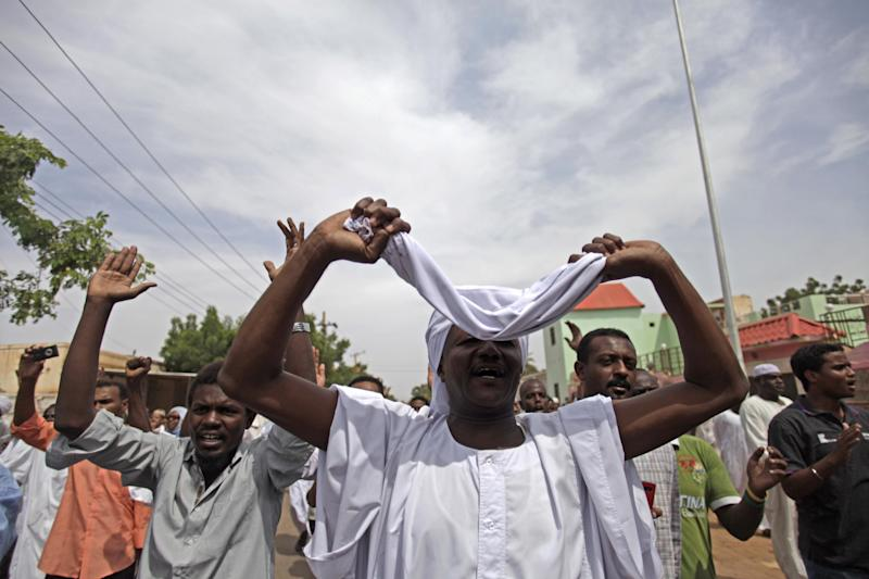 Sudanese anti-government protesters chant slogans after the Friday noon prayer in the Omdurman district of northern Khartoum, Sudan, Friday, Sept. 27, 2013. Sudanese protesters have taken to the streets across the capital and other key cities, some chanting for the ouster of President Omar al-Bashir, despite a crackdown on an eruption of protests this week that rights groups say killed at least 50 people. (AP Photo/Khalil Hamra)