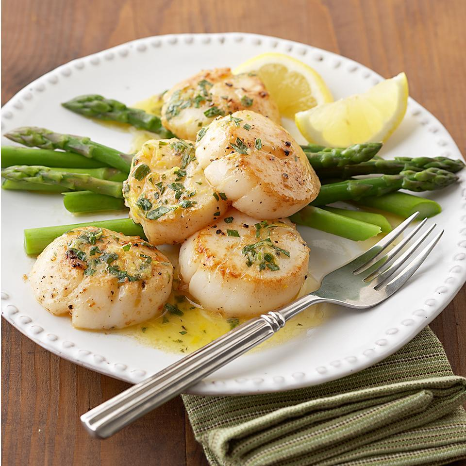 "<p>In this 15-minute recipe, crisp and tender asparagus spears serve as a vibrant base for lemon- and tarragon-flavored sea scallops. <a href=""http://www.eatingwell.com/recipe/269217/tarragon-scallops-on-asparagus-spears/"" rel=""nofollow noopener"" target=""_blank"" data-ylk=""slk:View recipe"" class=""link rapid-noclick-resp""> View recipe </a></p>"