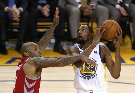 May 26, 2018; Oakland, CA, USA; Golden State Warriors forward Kevin Durant (35) shoots against Houston Rockets forward PJ Tucker (4) in game six of the Western conference finals of the 2018 NBA Playoffs at Oracle Arena. Mandatory Credit: Cary Edmondson-USA TODAY Sports