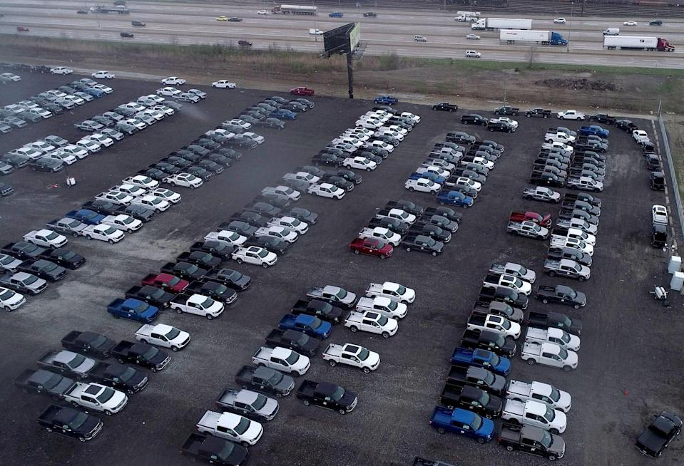 New Ford F-150 pickup trucks sit on a lot of the Department of Public Works rail yard off I-96 near Evergreen in Detroit on April 15, 2021. The trucks are waiting for semiconductors, the company said. Trucks will get quality checks done before being shipping to dealers.