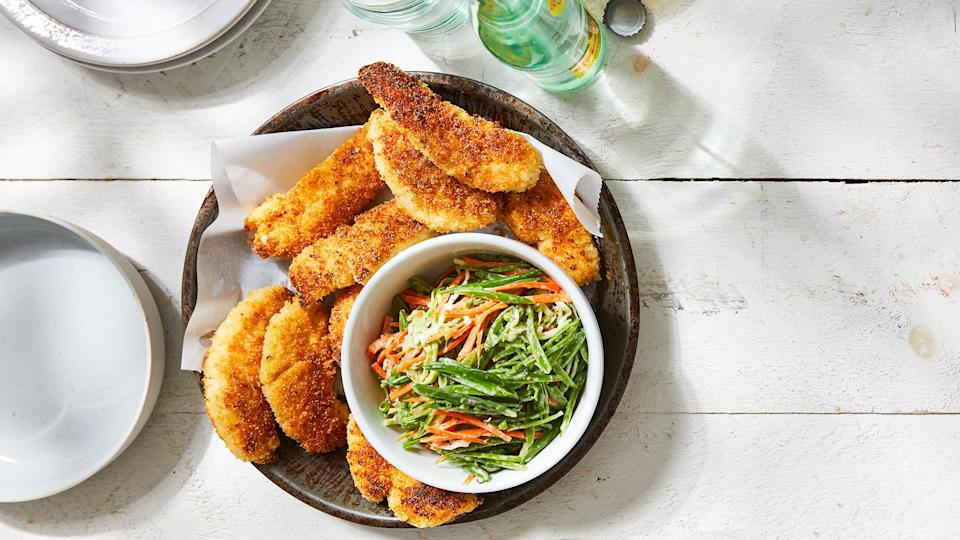 """<p>The buttermilk marinade lets these fried chicken tenders get crispy on the outside and stay deliciously juicy on the inside. The fresh crunchy slaw helps balance the richness of the chicken. Don't have buttermilk on hand? Make a substitute by mixing the equivalent amount of milk with 1 tablespoon of lemon juice or white vinegar.</p> <p> <a href=""""https://www.eatingwell.com/recipe/7895887/buttermilk-fried-chicken-tenders-with-snap-pea-slaw/"""" rel=""""nofollow noopener"""" target=""""_blank"""" data-ylk=""""slk:View recipe"""" class=""""link rapid-noclick-resp""""> View recipe </a></p>"""