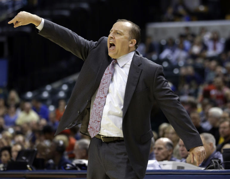 Chicago Bulls head coach Tom Thibodeau directs his team as they play against the Indiana Pacers in the first half of an NBA preseason basketball game in Indianapolis, Saturday, Oct. 5, 2013. (AP Photo/Michael Conroy)