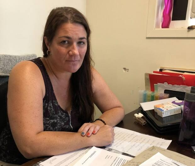 Shawna Stiles hopes the Department of Social Development will allow her to continue living in her home with window air conditioners, but she fears she may become homeless by the end of this month.  (Maeve McFadden/CBC - image credit)