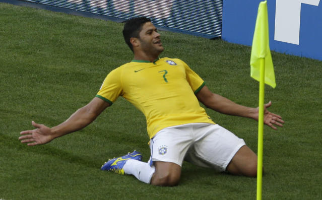 Brazil's Fred celebrates before his goal was disallowed due to a handball during the World Cup round of 16 soccer match between Brazil and Chile at the Mineirao Stadium in Belo Horizonte, Brazil, Saturday, June 28, 2014. (AP Photo/Hassan Ammar)